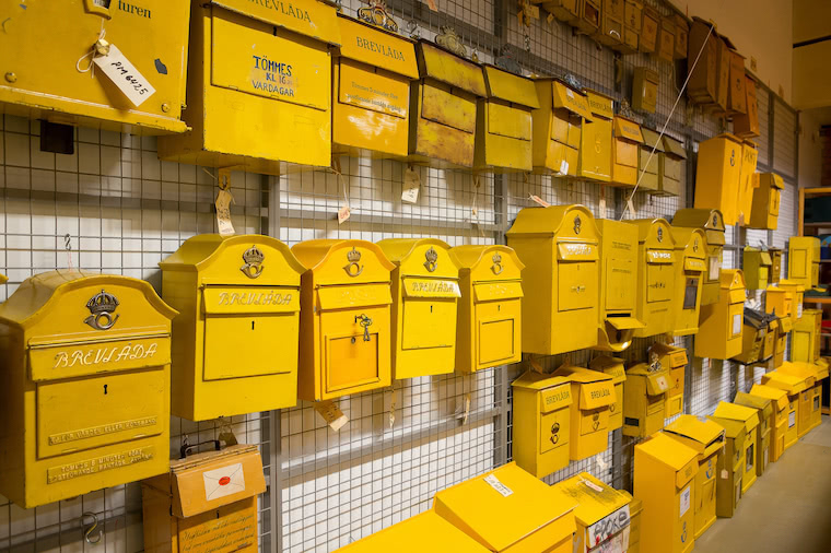 Vintage yellow mailboxes displayed at the Postal Museum