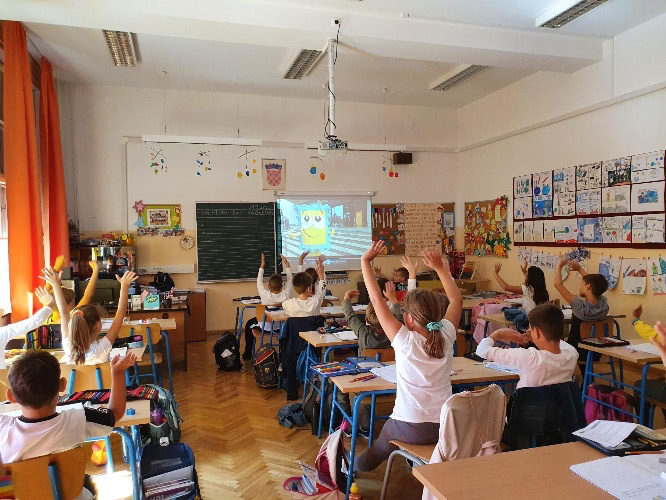 Students in a school class watching a video